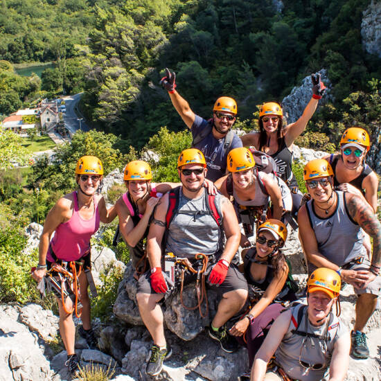 image of a group of people rock-climbing in the mountains